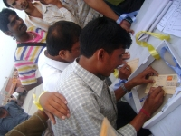 Vendors writting postcard to CM