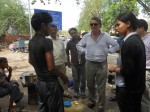 Business Leaders Interacting with Street Vendors
